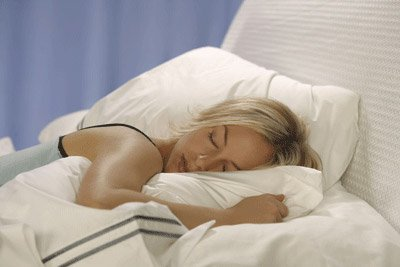 Image of Woman Sleeping on a Comfortable Mattress