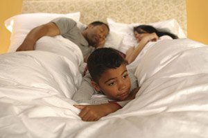 Image of Husband and Wife Sleeping Comfortably with Little Boy